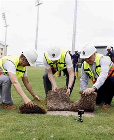 The final pieces of grass are laid on the Conghua Training Centre's turf track by Mr. Winfried Engelbrecht-Bresges, Chief Executive Officer (centre), Mr. Anthony Kelly, Executive Director, Racing Business & Operations (right) and Mr Philip Chen, Director of Property (left).