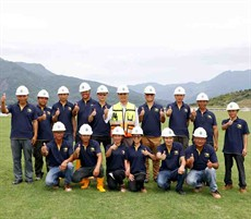 Members of the Conghua Training Centre tracks team, including Mr Jackson Wong (back row, centre) celebrate the completion of turf laying at CTC in May 2017.