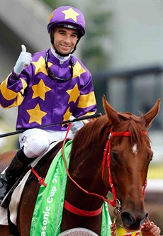 Joao Moreira gives a thumbs up as he returns aboard Panasonic Cup winner Western Express.