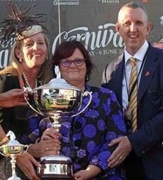 Peter and Patty Tighe with Debbie Kepitis at a trophy presentation