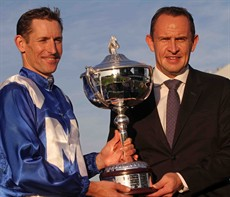 Hugh Bowman with Chris Waller … another addition to the trophy room