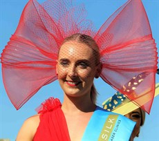 Madelaine Cvirn took out the millinery award with a bright red oversized bow inspired fascinator that complemented her red dress. 