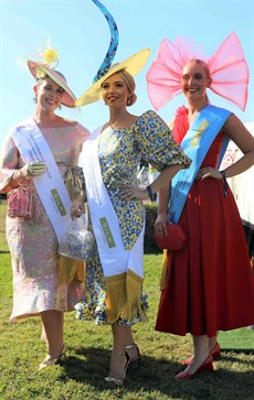 Tatianna Hoffmann won the Darwin Cup Fashions on the Field competition dressed in a yellow and blue leopard print dress and peacock millinery head piece.